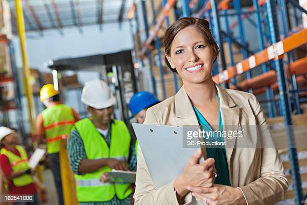 Company executive leading inspection in shipping distribution warehouse