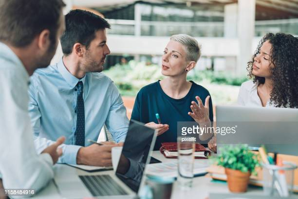 company executives in discussion - advice stock pictures, royalty-free photos & images