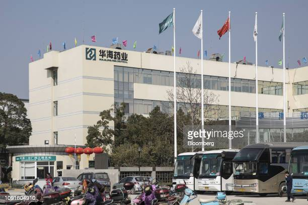 Company flags fly at the Zhejiang Huahai Pharmaceuticals Co Chuannan branch production base in Linhai Zhejiang Province China on Wednesday Jan 23...