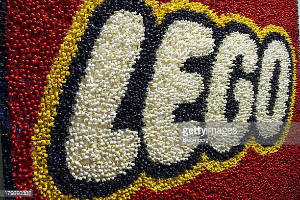 A company logo constructed from toy figures stands on display in the reception area at the headquarters of Lego A/S in Billund Denmark on Thursday...