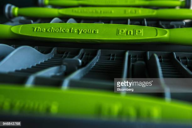 A company logo is displayed on a the handle of a branded shopping cart outside a Pick n Pay Stores Ltd supermarket in Johannesburg South Africa on...