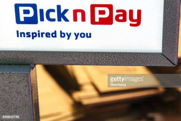 A company logo sits by the check out area inside a Pick n Pay Stores Ltd supermarket in Johannesburg South Africa on Monday April 9 2018 As trade...