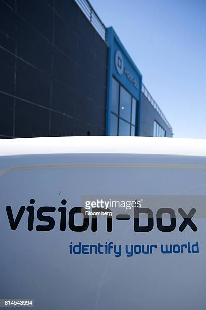 A company logo sits on display outside the manufacturing offices for VisionBox Solucoes De Visao Por Computador SA which make electronic identity...