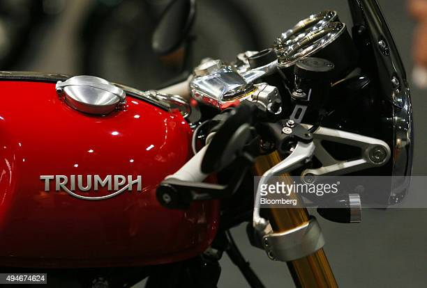 A company logo sits on the fuel tank of a Triumph Bonneville Thruxton R motorbike made by Triumph Motorcycles Ltd stands on display in London UK on...