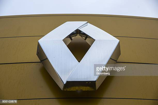 A company logo sits outside a Renault SA automobile dealership in Albi France on Friday Jan 15 2016 Renault offices in France were searched by...