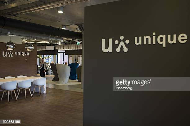 Company logos hang inside the Unique job center flagship store operated by USG People NV in Amsterdam Netherlands on Tuesday Dec 29 2015 Recruit...