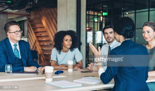 company management on a meeting - legal system stock pictures, royalty-free photos & images