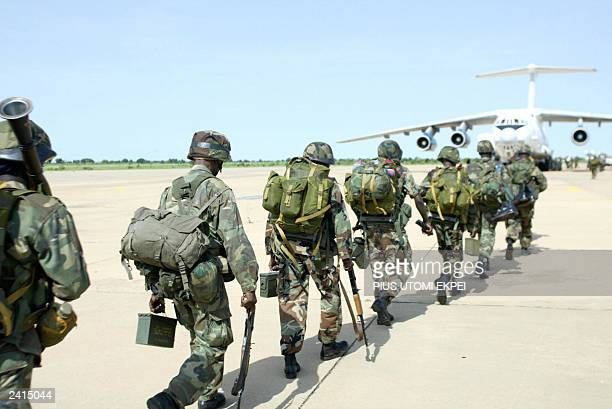 A company of 110 infantrymen the first element of the 776strong 26th mechanised infantry battalion boards a United Nations aircraft 16 August 2003 at...