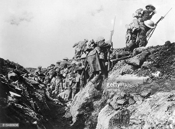 A company of Canadian soldiers go over the top from a World War I trench