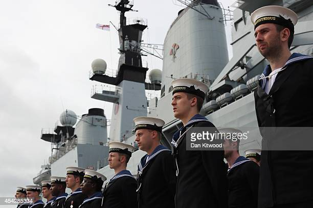 Company of the HMS Illustrious stand in formation during her decommissioning ceremony on August 28 2014 in Portsmouth England The HMS Illustrious was...