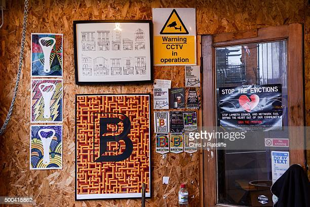 Company posters and a campaign poster supporting local businesses hang on the walls at inner city craft beer makers Brixton Brewery on December 8...