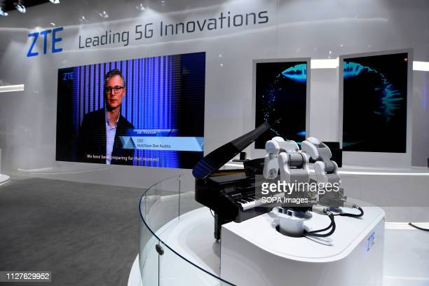 L´HOSPITALET CATALONIA SPAIN ZTE company stand with robots playing the piano seen at the Mobile World Congress in Barcelona