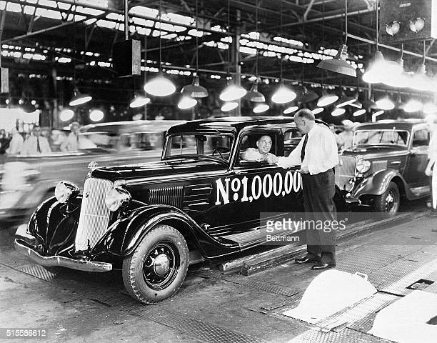 Company vice president BE Hutchinson shakes hands with founder Walter P Chrysler in Detroit to celebrate the production of the millionth Plymouth...