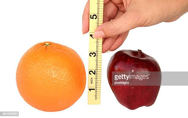 comparing apples to oranges - misinformation stock pictures, royalty-free photos & images