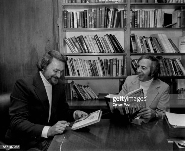 Comparing notes as they thumb through each other's novel are Clive Cussler left and Ben E Simpson Credit Denver Post