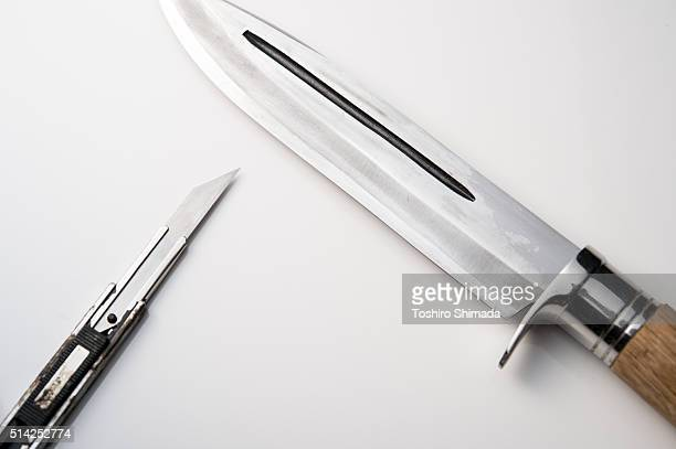 Comparison between a knife and a cutter