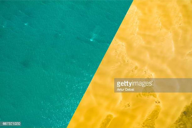 comparison view of two pictures showing beautiful contrast of planet earth taken from aerial view with a drone, with blue ocean view with the contrast of dry desert land with dunes. - gegensatz stock-fotos und bilder