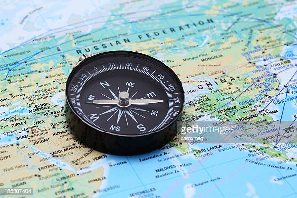 compass and map - china east asia stock pictures, royalty-free photos & images