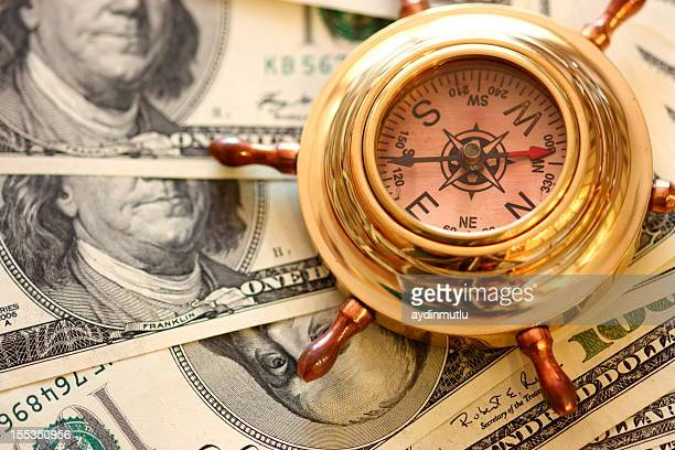 compass and money - dollar sign key stock photos and pictures