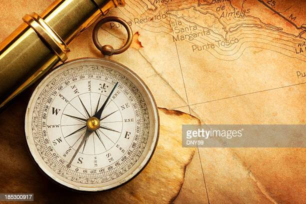 compass and spyglass on a map - compass stock pictures, royalty-free photos & images