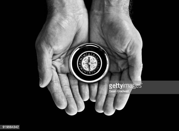 compass in hand - north stock pictures, royalty-free photos & images