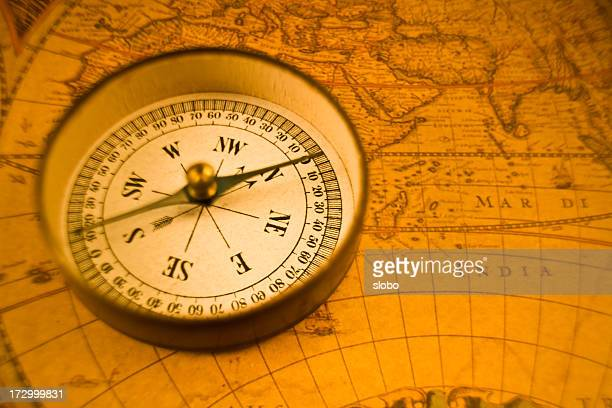 compass on antique map - north stock pictures, royalty-free photos & images
