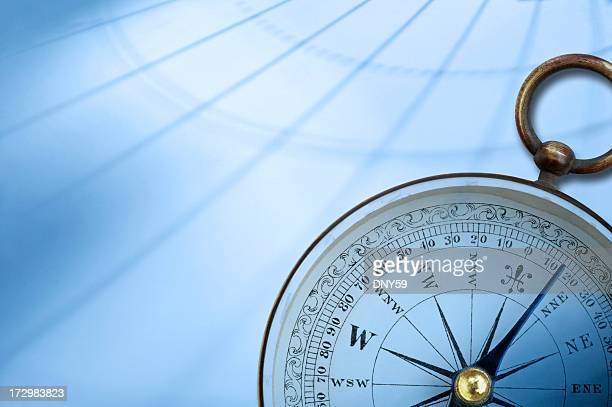 Compass on background created by latitude and longitude lines