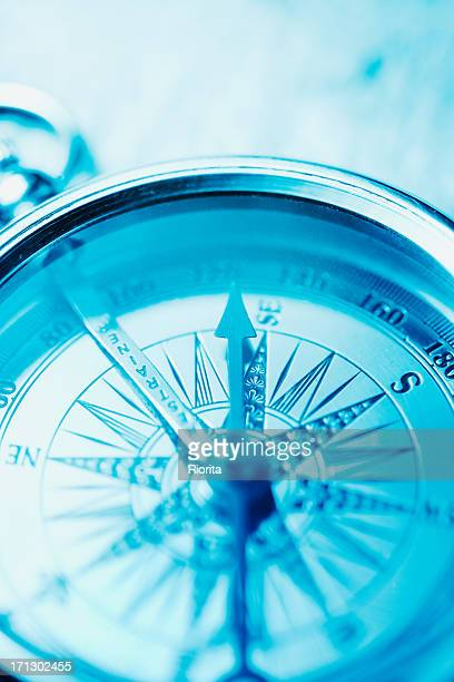 Compass on blue
