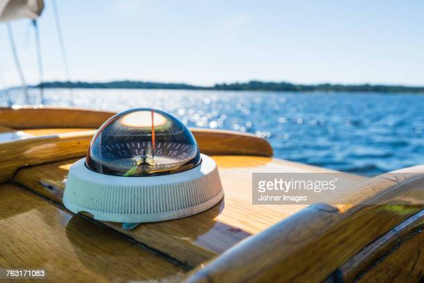 compass on boat - navigational equipment stock pictures, royalty-free photos & images