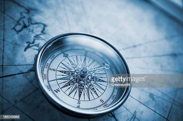 compass on old map - compass stock pictures, royalty-free photos & images