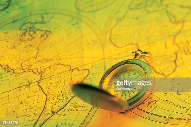 Compass on world map in green and yellow