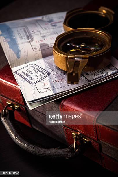 Compass, Passport, and Briefcase