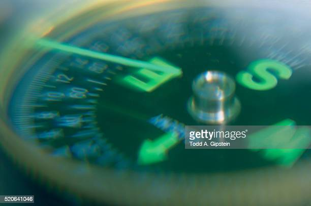 compass pointing east - gipstein stock pictures, royalty-free photos & images