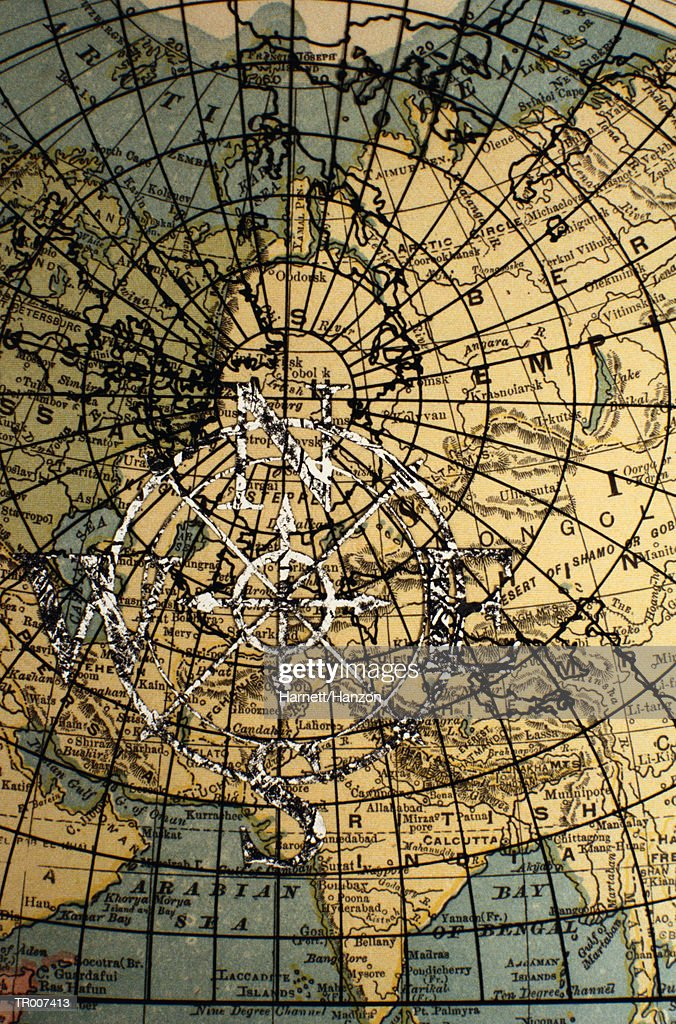 Compass Rose On A Detail Of A World Map Stock Photo Getty Images