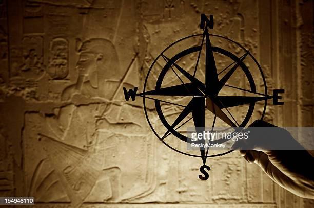 Compass Silhouette Against Hieroglyphs