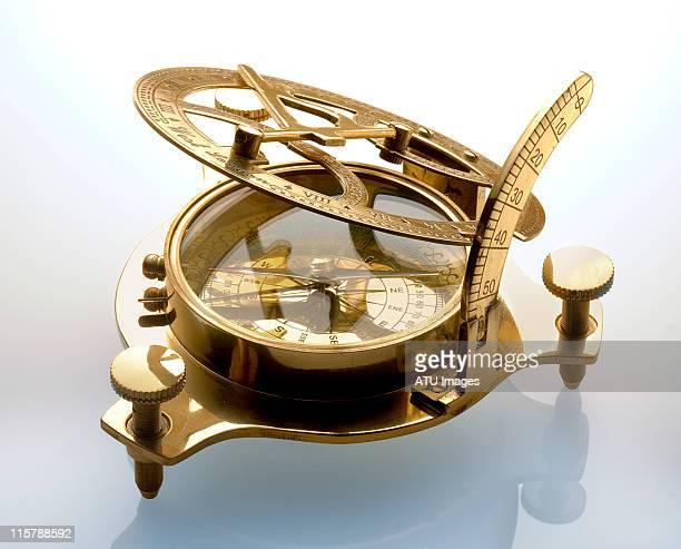 Compass sundial on white