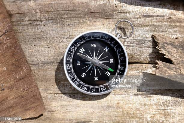 compass travel outdoors adventure wanderlust - compass stock pictures, royalty-free photos & images