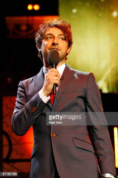 Compere Alex Zane performs on stage as part of Orange RockCorps at the Royal Albert Hall on September 25 2009 in London England