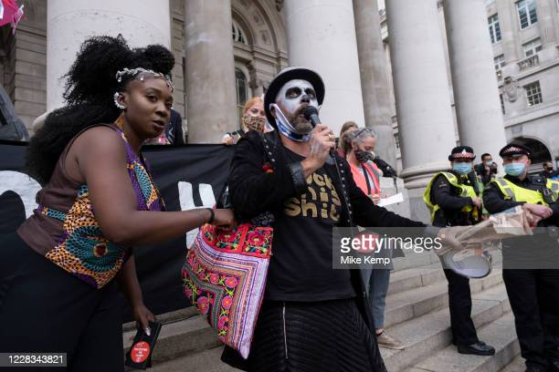 Compere leads the Walk of Shame disruptive mach through the City of London by environmental group Extinction Rebellion on 4th September 2020 in...