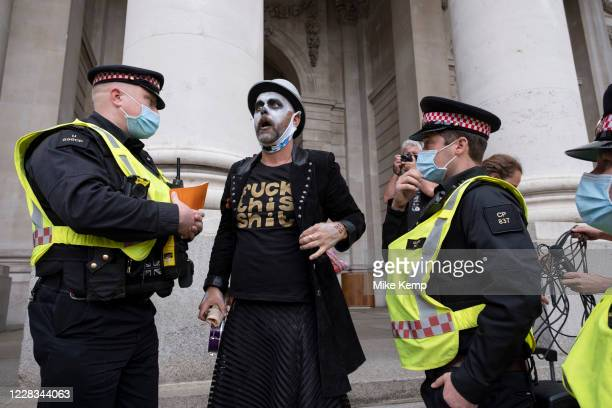 Compere leads the Walk of Shame disruptive mach through the City of London by environmental group Extinction Rebellion as police try to move the...