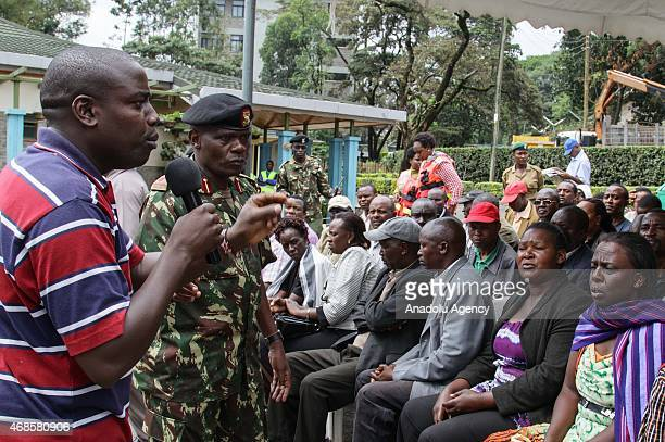 Competent informs people in front of the morgue of Chiromo Campus of Nairobi University on April 04, 2015 as they wait to identify the corps of their...