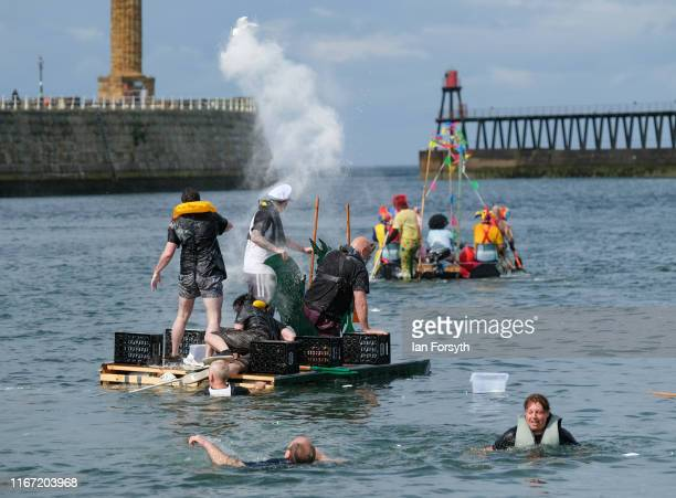 Competing crews in a raft race throw flour at each other during the annual Whitby Regatta on August 10 2019 in Whitby England At over 170 years old...