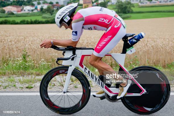 Competing in the Datev Challenge Roth German triathlete Jan Frodeno is seen cycling near Heideck Bavaria Germany 17 July 2016 In the 15th Roth race...