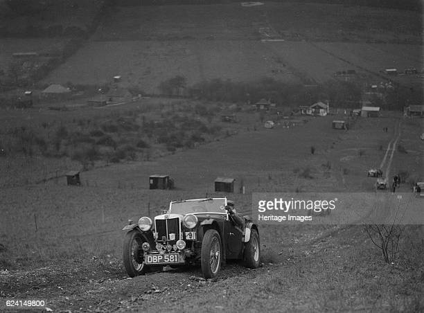 MG TA competing in the London Motor Club Coventry Cup Trial Knatts Hill Kent 1938 Artist Bill BrunellMG TA 1292 cc Vehicle Reg No DBP581 Event Entry...