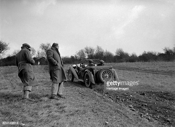 MG TA competing in the London Motor Club Coventry Cup Trial Knatts Hill Kent 1938 Artist Bill BrunellMG TA 1936 1292 cc Vehicle Reg No DLC85 Place...