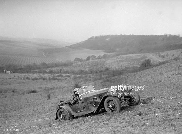 HRG competing in the London Motor Club Coventry Cup Trial Knatts Hill Kent 1938 Artist Bill BrunellHRG 1496 cc Vehicle Reg No BUE743 Event Entry No...