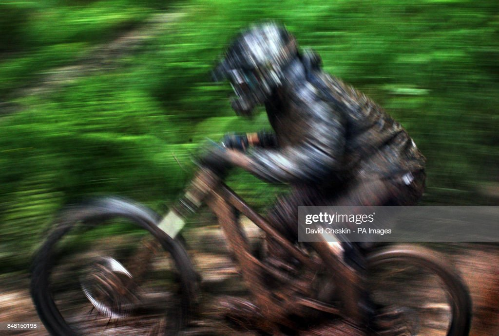 Competing Mountain Bike racers try out the forest trails