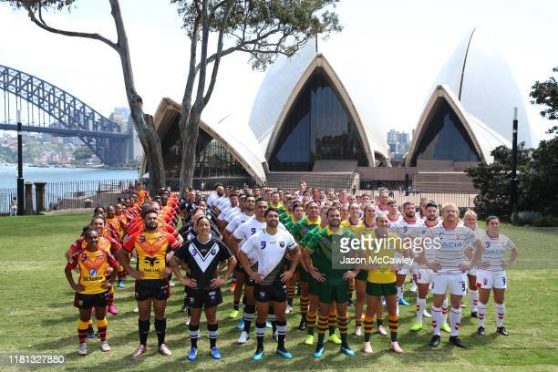 Competing nations in the men's a women's competition pose for a group photo during the Rugby League World Nines media opportunity at the Royal...