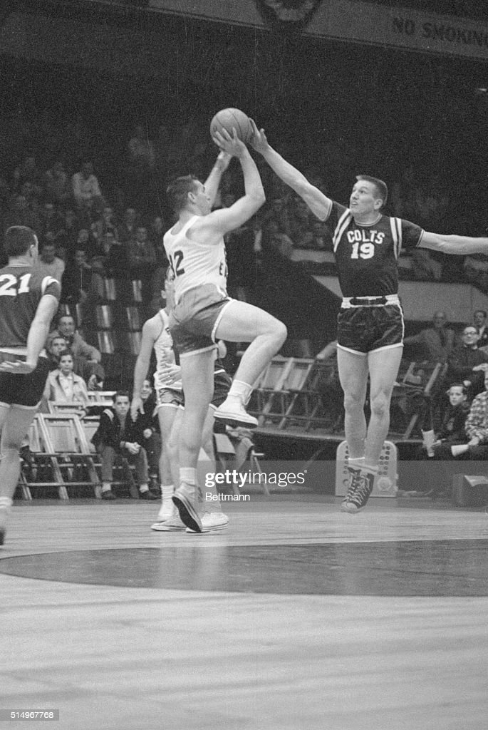 Competing on the court instead of the gridiron, Baltimore Colts quarterback Johnny Unitas (right) blocks a shot attempted by Tom Scott of the Philadelphia Eagles in a game here, Jan. 28. The Colts won the basketball exhibition, 37-55.