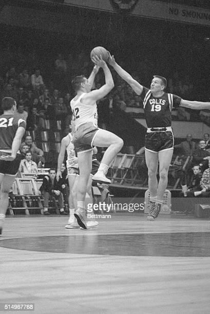 Competing on the court instead of the gridiron Baltimore Colts quarterback Johnny Unitas blocks a shot attempted by Tom Scott of the Philadelphia...